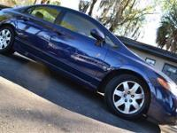 Provided is this 2006 Honda Civic LX in Royal Blue