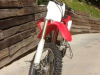 Year: 2006Exterior Color: RedMake: HondaEngine Size