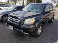 Take command of the road in our 2006 Honda Pilot EX 4x4