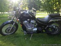 It has a 600 CC engine, 11,400 miles, a windshield and