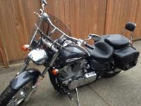Low mileage (11,500) motorcycle. Mustang seat for extra