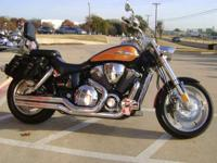 Custom paint job, exhaust, saddlebags, backrest, chrome