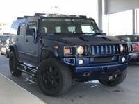 A chance to own one of the coolest Hummer H2's we've
