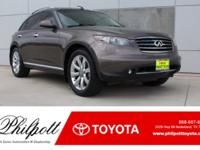 This 2006 INFINITI FX35 comes complete with:-Rear-view