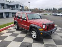 Red 2006 Jeep Liberty Sport 4WD 6-Speed Manual