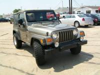 Options Included: Easy Folding Softtop, 7 Speakers,