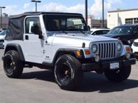 This 2006 Jeep Wrangler Sport comes with Black cloth