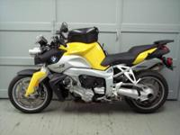 2006 BMW K1200R, yellow with 18k miles. This beautiful