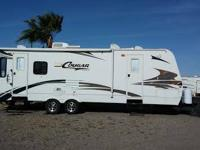 This 2006 Keystone Cougar 294 RLS is a stunning 31ft