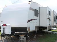 32 foot Keystone Laredo Travel Trailer. Set up on