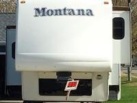 This is a 2006 Keystone Montana 3475RL that is Smoke &