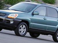 Come see this 2006 Kia Sportage LX. Its Automatic