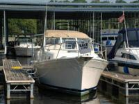 This is a spick-and-span, like new Mainship Pilot 30