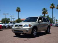This Beige 2006 Mazda Tribute is priced to sell which