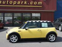 This yellow 2006 MINI Cooper is a keeper. Priced at