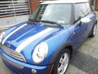 THIS IS A 1 OWNER DARK METALIC BLUE 2006 MINI COOPER