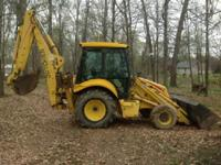 2006 New Holland LB75.B. This is a 2006 New Holland
