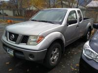 This Nissan Frontier has a V6, 4.0L; DOHC 24V high