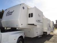 A 35' Fifth Wheel with four slide-outs, power leveling