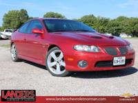 2D Coupe, 6.0L V8 SFI Aluminum, RWD, and Torrid Red.