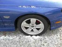 selling 4 stock gto rims with brand new tires (kumho