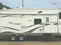 Very nice 5th Wheel with 3 bunks in the rear.  Two