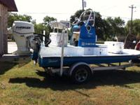 2006 year model boat, motor & trailer. 90 hp evinrude