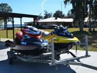 Up for auction is a pair of Sea-Doos and trailer. The