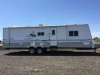 Manufactured by Skyline RV, this Nomad 3150 bunkhouse