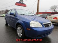 Exterior Color: blue, Interior Color: gray, Body: Sedan