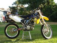 06 RMZ 250 IN PERFECT CONDITION. LOW HOURS, NEW
