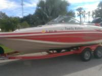 This is a spick-and-span 2006 Tahoe Deck Boat, 20'