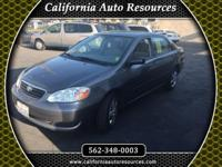 2006 Toyota Corolla, very low miles, backed up by a