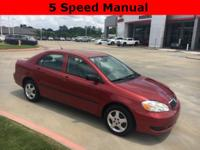 2006 Toyota Corolla in Red exterior and Stone interior,