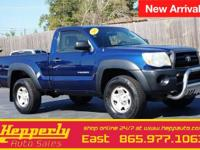 Clean CARFAX. This 2006 Toyota Tacoma in Blue features.