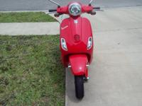 Vespa LX150 with 1100 miles. I added a sidestand and