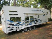 2006, Weekend Warrior Toy Hauler, sleeps 8. Has total