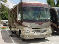 2006 Winnebago Adventure 33V, 2 slide outs w/covers.