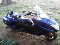 2006 Yamaha Morphous scooter in bright blue with just