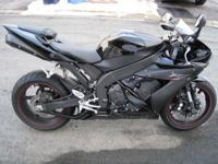Description This is an 06 all black yamaha r1 raven.