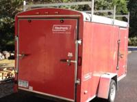 2006 Enclosed Haulmark Trailer (Red). 6 ft. x 12 ft.