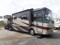 BEAUTIFUL MOTORHOME FOLKS!! THIS UNIT HAS: 4-SLIDEOUTS