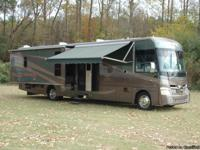 This motorhome with full body paint is a 39' Class A RV