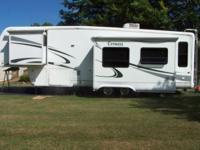 Beautiful Newmar Cypress 32' ckre fifth wheel. Has two