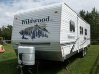 2006 Wildwood LE 28BGSS(back garage super slide).Weight