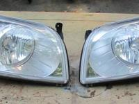 Stock Dodge/Chrysler headlights in great condition.