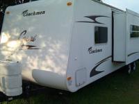 This 30' camper has 1 power slide, refrigerator/freezer