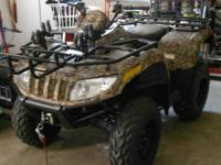 like new 1100 miles 4 by 4 atv auto camo option