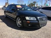This BLACK AUDI A8 IS A ONE OWNER CLEAN CARFAX VEHICLE