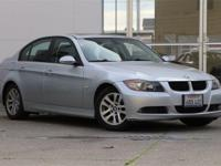 You are looking at a stunning BMW 328i in Titanium